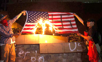 Flag-burning foreigners : AP Photo